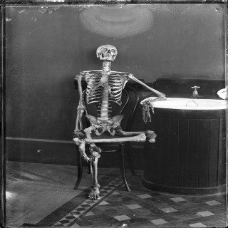 Some committee's recording clerk, waiting for action to happen.